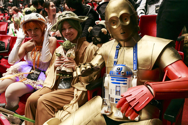 "Star Wars fans pose for a photograph outside the Parco Theater in Shibuya during the launch event for ""Star Wars: Episode VII – The Force Awakens"" MovieNEX premium box on May 4, 2016, Tokyo, Japan. The box which contains DVD and Blue-ray with bonus features costs 9,800 yen (91.42 USD). (Photo by Aflo/Splash News)"