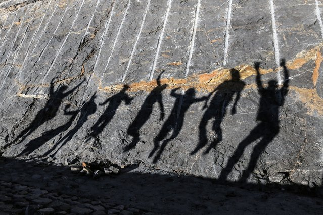 Shadow of people jumping falls on Jabal Jais Mountain, Ras al-Khamiah, 115Kms north Dubai, United Arab Emirates, 02 February 2018. Jebel Jais zip line was opened for public on 02 February after it was awarded Guinness World Record as world's longest zip line stretching over 2.83 kilometers starting from the peak of Jebel Jais at 1,680m above sea level. A ride on the zip line costs 650AED (142 Euro) per person. (Photo by Mahmoud Khaled/EPA/EFE/Rex Features/Shutterstock)