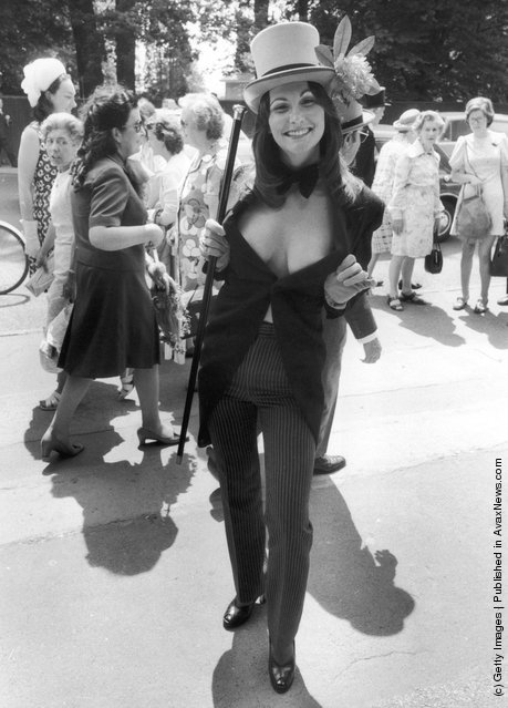 1974: Erotic actress Linda Lovelace (1949 - 2002) wears a top hat and tails with pinstripe trousers to the third day of Royal Ascot