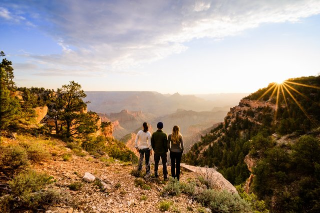 Winner of the National Park Foundation's photo contest; Honorable Mention: Fan Favorite. Grand Canyon National Park, Arizona. Three friends enjoy sunrise over the Grand Canyon. (Photo by Peter Blanchard)