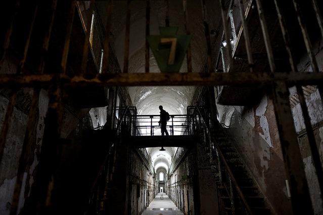 A visitor wanders through block 7 of Eastern State Penitentiary in Philadelphia, Pennsylvania April 30, 2014. (Photo by Mark Makela/Reuters)