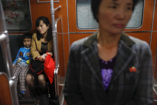 People travel on a train, stopping at a subway station visited by foreign reporters, in central Pyongyang, North Korea on April 14, 2017. (Photo by Damir Sagolj/Reuters)