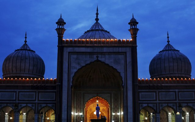 A Muslim boy offers evening prayer after having his iftar (breaking of fast) meal during the holy month of Ramadan at the Jama Masjid (Grand Mosque) in the old quarters of Delhi, India, July 10, 2015. (Photo by Adnan Abidi/Reuters)