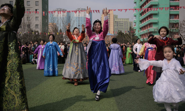 "Dancers perform outside a voting centre at the ""Pyonyang number four Primary School"" during voting for the Supreme People's Assembly elections, in Pyongyang on March 10, 2019. North Koreans went to the polls for an election in which there could be only one winner. Leader Kim Jong Un's ruling Workers' Party has an iron grip on the Democratic People's Republic of Korea, as the isolated, nuclear-armed country is officially known. (Photo by Ed Jones/AFP Photo)"