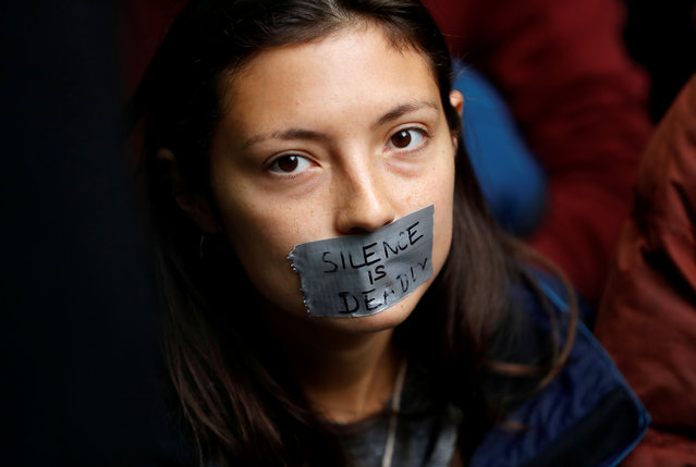 A protester with her mouth taped is pictured outside the BBC Headquarters during an Extinction Rebellion demonstration in London, Britain on October 11, 2019. (Photo by Peter Nicholls/Reuters)