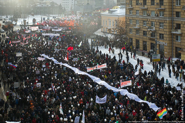 Russian oppostion activists take part in a rally and march to Bolotnaya Square on February 4, 2012 in Moscow, Russia