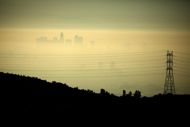 Downtown Los Angeles is seen behind an electricity pylon through the morning marine layer in Los Angeles, California, U.S., August 20, 2019. (Photo by Lucy Nicholson/Reuters)