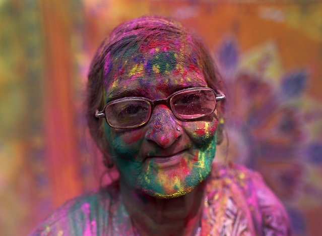 A widow daubed in colours takes part in Holi celebrations organised by non-governmental organisation Sulabh International at a widows' ashram at Vrindavan, in the northern Indian state of Uttar Pradesh, in this March 3, 2015 file photo. (Photo by Ahmad Masood/Reuters)