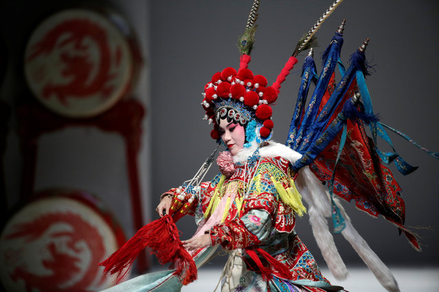 A Beijing Opera performer dances for a show by designer Hao Weimin at China Fashion Week, China, October 28, 2019. (Photo by Jason Lee/Reuters)