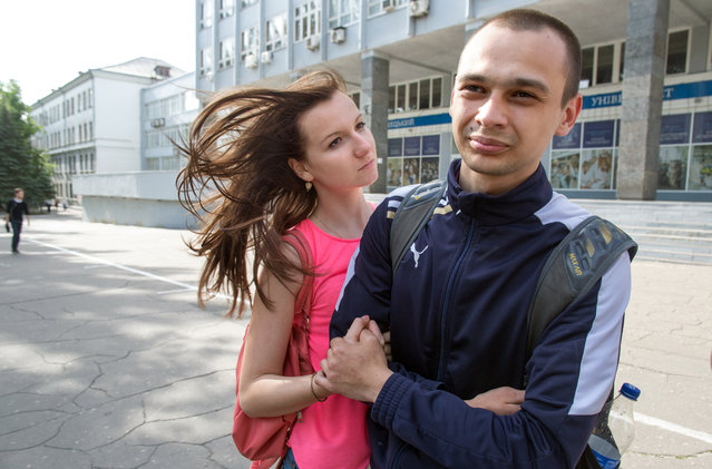 """Kirill Alonzov, 22, a student at Donetsk National University, opposes the separatist movement. """"It's the simplicity of communist ideology, a conservative way of thinking,"""" he says, standing with his girlfriend and fellow student Kate Leonova, 20, on May 23, 2014. (Photo by Evelyn Hockstein/The Washington Post)"""