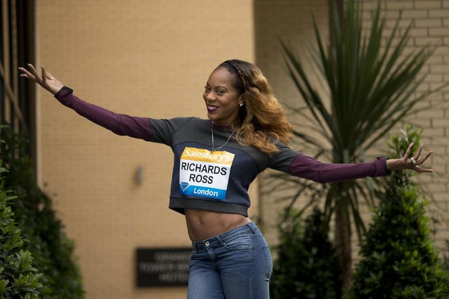 U.S. 400 metres Olympic champion Sanya Richards-Ross poses for photographers before speaking in a press conference in a hotel, ahead of competing in the Diamond League athletics meeting at the Olympic Stadium in London, Thursday, July 23, 2015. (Photo by Matt Dunham/AP Photo)