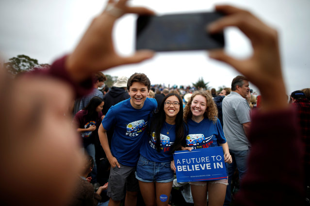Supporters pose for a photo as they wait for U.S. Democratic presidential candidate Bernie Sanders to speak at a campaign rally in Santa Barbara, California, U.S. May 28, 2016. (Photo by Lucy Nicholson/Reuters)