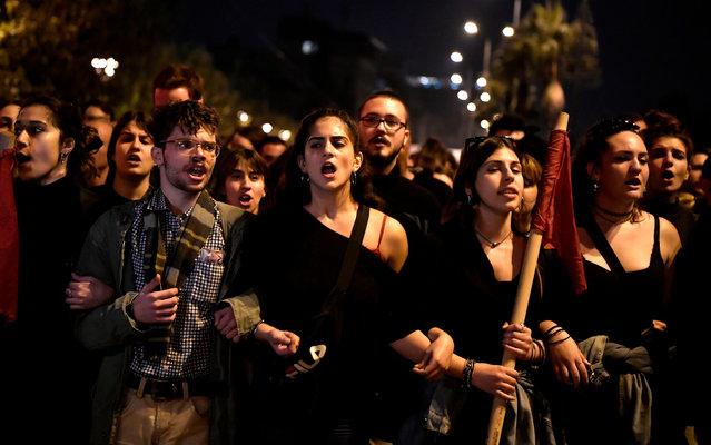 Students shout slogans during the annual march towards the US embassy on November 17, 2019 in Athens, to commemorate the 1973 students' uprising against the US-backed military junta. Five thousand police will deploy in Athens on November 17 for an annual demonstration marking the anniversary of a 1973 anti-junta uprising that regularly descends into violence. This year the protest looks set to be dominated by opposition to the new conservative government, elected in July on a pledge to strengthen law and order. (Photo by Louisa Gouliamaki/AFP Photo)