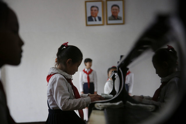 Portraits of the late North Korean leaders Kim Il Sung, left, and Kim Jong Il, right, hang in a classroom where school girls take music lessons, Thursday, May 7, 2015, in Pyongyang, North Korea. (Photo by Wong Maye-E/AP Photo)