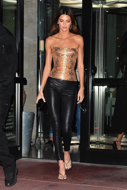 Kendall Jenner eats dinner at Milos in Miami Beach,Florida on December 5, 2019. Kendall met up with friends wearing a snakeskin top. (Photo by Robert O'Neil/Splash News and Pictures)