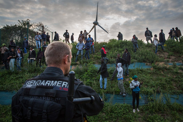 Gendarmerie attempt to prevent people from entering the Eurotunnel terminal in Coquelles on July 30, 2015 in Calais, France.  Hundreds of migrants are continuing to attempt to enter the Channel Tunnel and onto trains heading to the United Kingdom. (Photo by Rob Stothard/Getty Images)