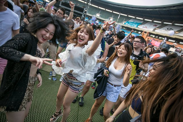 South Korean youths dance to electronic music during the Ultra Music Festival Korea at Olympic Stadium on June 10, 2016 in Seoul, South Korea. (Photo by Jean Chung/Getty Images)