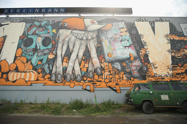 A street art mural by Da Mental Vaporz, or DMV, is visible in Friedrichshain district on June 26, 2014 in Berlin, Germany. Berlin, with its long tradition of counter-culture, has become a mecca for street art of all dimensions and messages. (Photo by Sean Gallup/Getty Images)