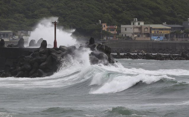 Huge waves from approaching Typhoon Soudelor crash into breakwaters off of Keelung, northeastern Taiwan, Friday, August 7, 2015. (Photo by Wally Santana/AP Photo)