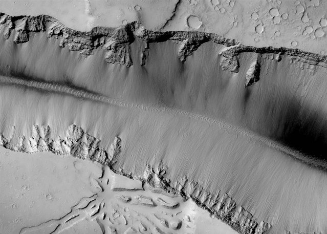 The high-resolution camera on NASA's Mars Reconnaissance Orbiter captured this picture of landforms near Grota Valles on Mars