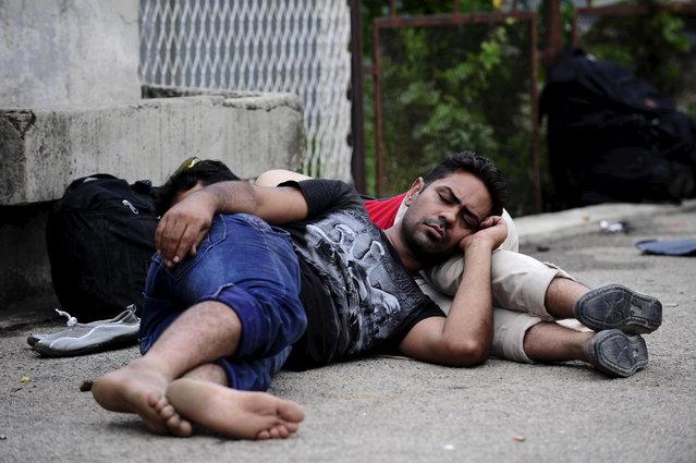 Migrants sleep on the ground at Gevgelija train station near the Greek border with Macedonia July 30, 2015. (Photo by Ognen Teofilovski/Reuters)