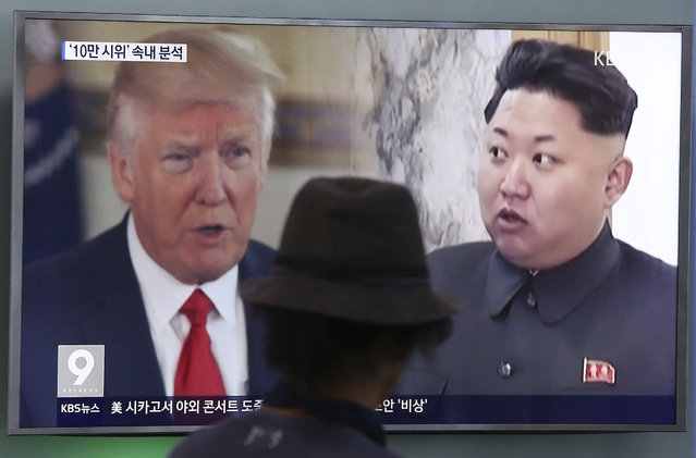 A man watches a television screen showing U.S. President Donald Trump, left, and North Korean leader Kim Jong Un during a news program at the Seoul Train Station in Seoul, South Korea, Thursday, August 10, 2017. North Korea has announced a detailed plan to launch a salvo of ballistic missiles toward the U.S. Pacific territory of Guam, a major military hub and home to U.S. bombers. If carried out, it would be the North's most provocative missile launch to date. (Photo by Ahn Young-joon/AP Photo)