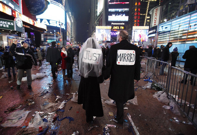 Melessa and Rick Clark leave the New Year celebration after exchanging vows in Times Square, New York January 1, 2010. (Photo by Jessica Rinaldi/Reuters)