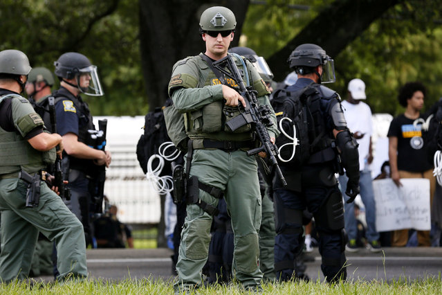 A police officer is seen near the headquarters of the Baton Rouge Police Department in Baton Rouge, Louisiana, U.S. July 9, 2016. (Photo by Jonathan Bachman/Reuters)