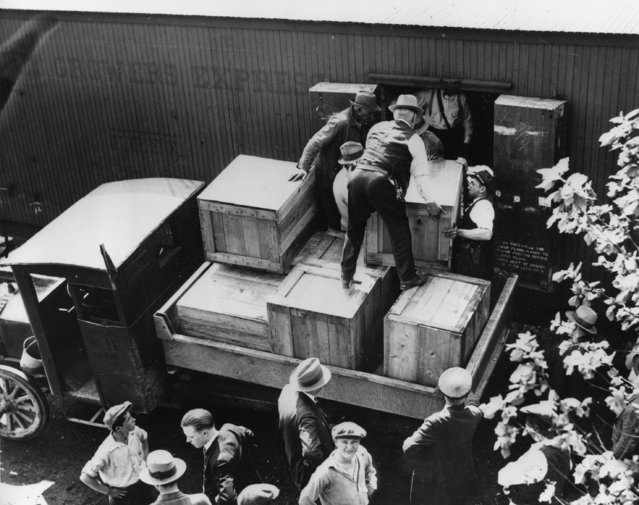 Authorities unload cases of whiskey crates labeled as green tomatoes from a refrigerator car in the Washington yards on May 15, 1929.  The grower's express cargo train was en route from Holandale, Fla., to Newark, N.J. (Photo by AP Photo)
