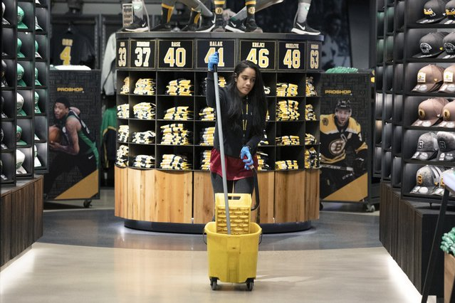 A cleaning person works in the pro shop selling merchandise for both the Boston Celtics and the Bruins at TD Garden in Boston, Saturday, March, 14, 2020. The NBA and the NHL, along with most major sports and sporting events in the United States have suspended play due to concern about the new coronavirus. For most people, the new coronavirus causes only mild or moderate symptoms, such as fever and cough. For some, especially older adults and people with existing health problems, it can cause more severe illness, including pneumonia. The vast majority of people recover from the new virus. (Photo by Michael Dwyer/AP Photo)