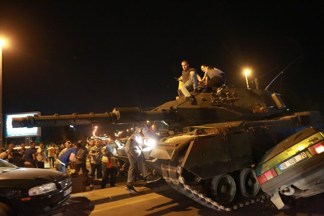 A tank crashes a car as people take streets in Ankara, Turkey during a protest agaist military coup on July 16, 2016. 42 dead in Ankara coup attempt clashes: TV citing prosecutor. Turkish military forces on July 16 opened fire on crowds gathered in Istanbul following a coup attempt, causing casualties, an AFP photographer said. The soldiers opened fire on grounds around the first bridge across the Bosphorus dividing Europe and Asia, said the photographer, who saw wounded people being taken to ambulances. (Photo by Adem Altan/AFP Photo)