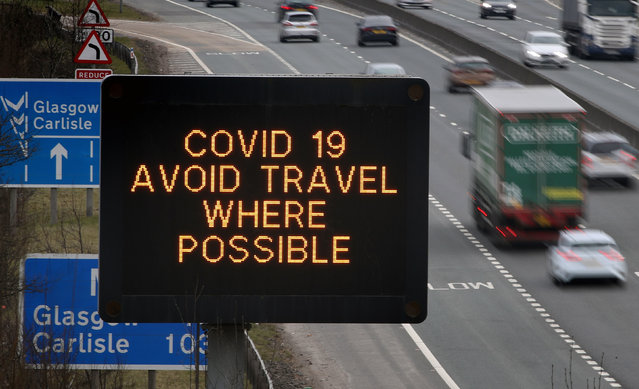 Coronavirus signage on the M80 motorway near Banknock, England on March 23, 2020. (Photo by Andrew Milligan/PA Images via Getty Images)