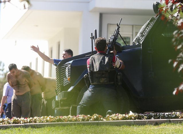 """Approximately 200 soldiers, attended """"Parallel State/Gulenist Terrorist Organization""""s coup attempt, are being taken under custody at Gendarmerie General Command's building in Ankara, Turkey on July 16, 2016. Parallel state is an illegal organization backed by U.S.-based preacher Fetullah Gulen. (Photo by Mehmet Murat Onel/Anadolu Agency/Getty Images)"""