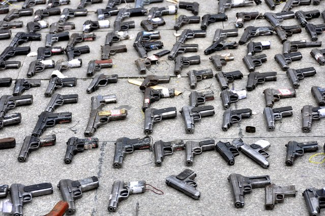 Pistols confiscated by the authorities are seen displayed on the ground during a massive destruction event of illegal weapons in Garze Tibetan Autonomous Prefecture, Sichuan province, China, September 1, 2015. (Photo by Reuters/Stringer)