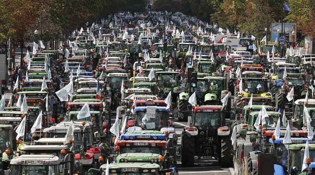 French farmers converge on the Place de la Nation square, driving their tractors on the Cours de Vincennes in Paris, France, September 3, 2015. Hundreds of tractors were heading towards Paris for a protest due to take place on Thursday where French farmers will call for more help with low prices and high costs in the European Union's largest agricultural producer country. (Photo by Charles Platiau/Reuters)
