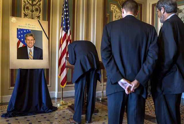 Duncan Currie signs a condolence book for J. Christopher Stevens, U.S. Ambassador to Libya, who was killed Tuesday during an attack in Behghazi, at the U.S. Capitol in Washington. (Photo by Brendan Hoffman/The New York Times)