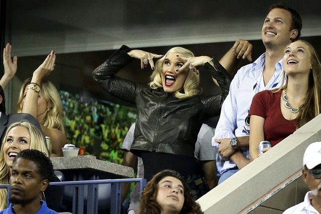 Gwen Stefani, center, gestures during the quarterfinal match between Roger Federer and Gael Monfils at the US Open in New York, on September 4, 2014. Federer came from two sets down to win. (Photo by John Minchillo/Associated Press)