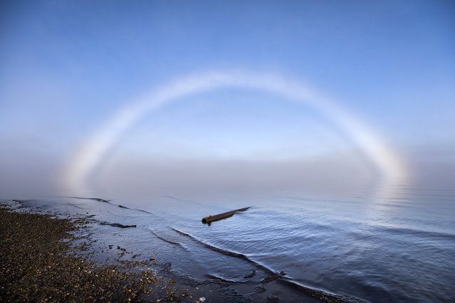 A fog bow floats above the Arctic Ocean near the end of the Dalton Highway in Prudhoe Bay, Alaska, USA, 05 September 2017. Though the Dalton ends 10 miles south of the Arctic Ocean in nearby Deadhorse, visitors can take a shuttle through the Prudhoe Bay Oil Fields, where public access is restricted, to reach the ocean. (Photo by Jim Lo Scalzo/EPA)