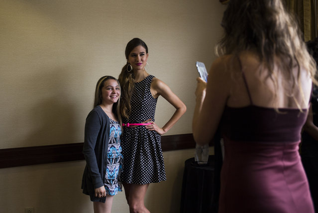 Formerly a participant on Americas Next Top Model, Victoria Henley poses with Heather Duenas, 14, of Stafford, Va., after speaking to camp attendees about the modeling industry at a modeling camp at the Courtyard Marriott Hotel in McLean, Va., on Tuesday, August 18th, 2015. (Photo by Brittany Greeson/The Washington Post)