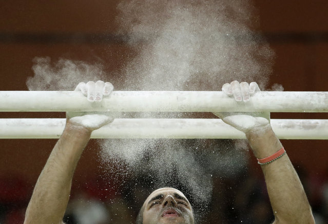 United States' Danell Leyva prepares for his performance on the parallel bars during the gymnastics exhibition gala at the 2016 Summer Olympics in Rio de Janeiro, Brazil, Wednesday, August 17, 2016. (Photo by Dmitri Lovetsky/AP Photo)