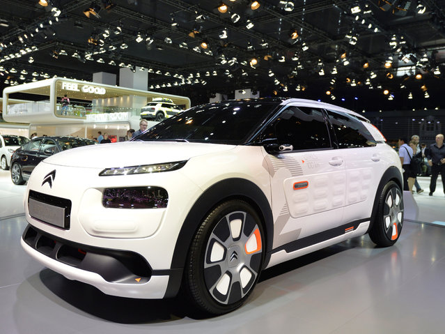 The new Citroen Concept car C4 Cactus Airflow is presented at the 2014 Paris Auto Show on October 2, 2014 in Paris on the first of the two press days. (Photo by Miguel Medina/AFP Photo)