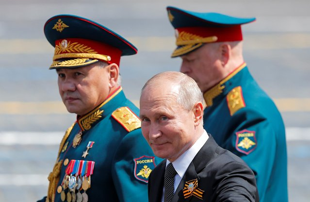 Russia's President Vladimir Putin, Defence Minister Sergei Shoigu and Chief of the Russian Land Forces Oleg Salyukov leave after the Victory Day Parade in Red Square in Moscow, Russia June 24, 2020. The military parade, marking the 75th anniversary of the victory over Nazi Germany in World War Two, was scheduled for May 9 but postponed due to the outbreak of the coronavirus disease (COVID-19). (Photo by Maxim Shemetov/Reuters)