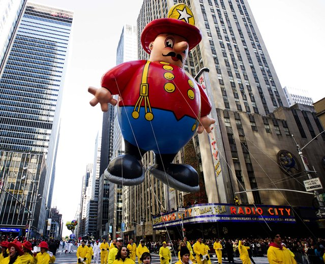 The Harold the Fireman balloon floats in the Macy's Thanksgiving Day Parade in New York. (Photo by Charles Sykes/Associated Press)