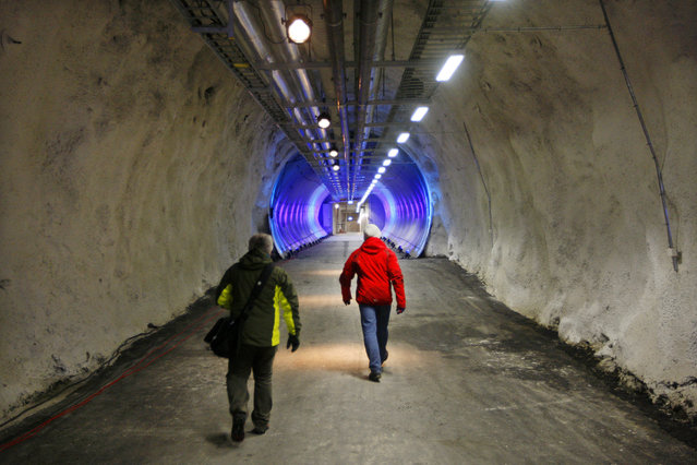 People walk into a seed vault on February 24, 2008 near Longyabyen. (Photo by Hakon Mosvold Larsen/AFP Photo)