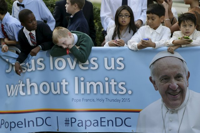 School children await Pope Francis' departure from the Vatican Embassy in Washington on day three of his first visit to the United States September 24, 2015. Fresh off his meeting with President Barack Obama, Pope Francis delivers a speech on Thursday to a U.S. Congress led by Republicans who have opposed Obama on issues of importance to the pontiff including climate change and immigration. (Photo by Gary Cameron/Reuters)
