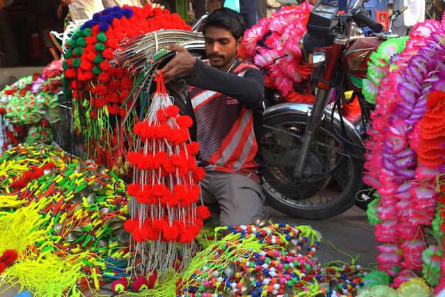 Pakistani shopkeeper display different decoration stuff use for sacrificial animals for the upcoming Eid ul-Adha in Lahore on July 24, 2020. (Photo by Rana Sajid Hussain/Pacific Press/Rex Features/Shutterstock)