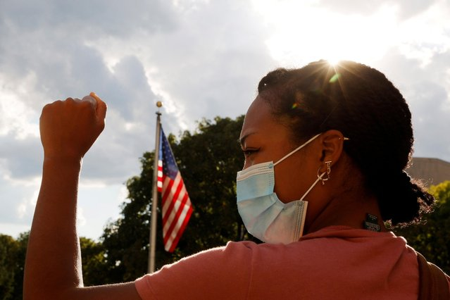 Adelana Akindes takes part in a demonstration against racial injustice by the Coalition to March on the Democratic Convention outside the site of the DNC, which will be a largely virtual event due to the coronavirus disease (COVID-19) outbreak, in Milwaukee, Wisconsin, U.S., August 17, 2020. (Photo by Brian Snyder/Reuters)