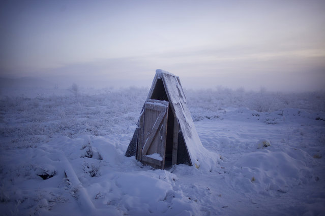 Toilets in the village are simple pits (covered by shacks like this) due to underground plumbing being impractical in the shifting, permanently frozen ground of Oymyakon. (Photo by Amos Chapple/Courtesy Images/RFE/RL)