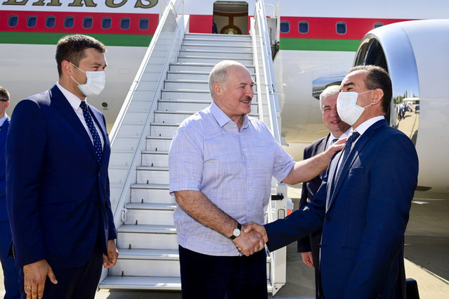 Belarusian President Alexander Lukashenko greets officials upon his arriving at the Black Sea resort of Sochi, Russia, Monday, September 14, 2020. Belarus' authoritarian president, Lukashenko is visiting Sochi for talks with Russian President Vladimir Putin a day after an estimated 150,000 flooded the streets of the Belarusian capital, demanding Lukashenko's resignation. (Photo by Andrei Stasevich/BelTA Pool Photo via AP Photo)