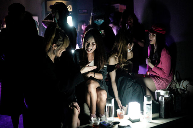 A women drink inside the disco bar on September 18, 2020 in Wuhan, Hubei province, China. As there have been no recorded cases of community transmission in Wuhan since May, life for residents is returning to normal. (Photo by Getty Images)